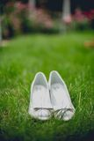Stylish modern wedding shoes against grass in bride's garden Royalty Free Stock Photos
