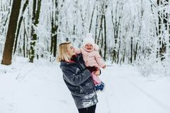 stylish mom with baby walk at street on winter stock photography