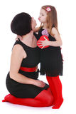 Stylish Mom and daughter kissing Stock Photo