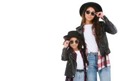 Stylish mother and daughter in leather jackets and sunglasses looking at camera. Isolated on white Stock Images