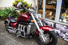Stylish Motorcycle on Santa Maria Street in Funchal Madeira. This is a narrow street in the old town of Funchal. It is full of Restaurants and cafes, but is royalty free stock photo