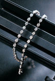 Stylish necklace hanging. On black bar Royalty Free Stock Photography