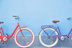 Stylish new bicycles near color outdoors. Stylish new bicycles near color wall outdoors Stock Images