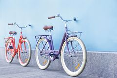 Stylish new bicycles near color wall. Outdoors Royalty Free Stock Photography