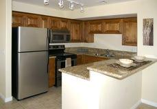 Stylish New Kitchen. A stylish, contemporary kitchen with chrome refrigerator Royalty Free Stock Photography