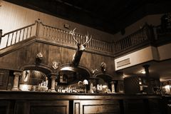 Stylish night bar with retro decor in sepia Stock Photography