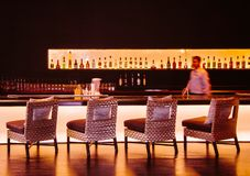 Stylish night club bar with well design furnitures and bartender royalty free stock image