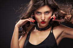 Stylish night flash fashion portrait of trendy casual young woman in black dress. Stock Image