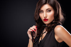 Stylish night flash fashion portrait of trendy casual young woman in black dress. Royalty Free Stock Images