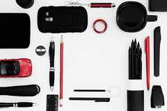 Stylish office workplace in black and red on a white background. Male strict style. Presentation. Frame. Blank notebook. Royalty Free Stock Photo