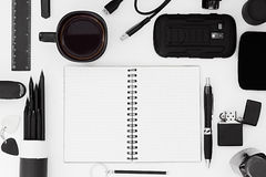 Stylish office workplace in black on a white background. Male strict style. Presentation. Frame. Blank notebook. Stock Image