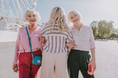 Stylish older ladies are walking in the park stock image