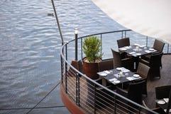 Stylish outdoors cafe Stock Image