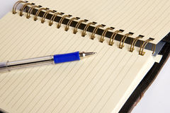 Stylish pad and pen Stock Photography