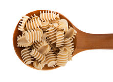 Rustic home made pasta, radiators, on spoon isolated over white Royalty Free Stock Images