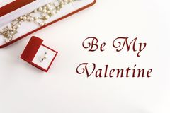 Stylish pearl ring and necklace,be my valentine text, greeting royalty free stock images