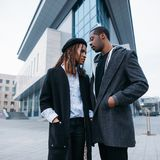 Stylish pedestrian couple. African American youth. On urban background. Young fashionable models, beauty concept Stock Image