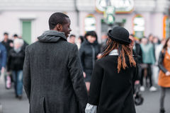 Stylish pedestrians. African American couple. Stylish pedestrians on crowd background. African American couple. Unrecognizable young people on street, city life Royalty Free Stock Photo