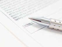 Stylish pen and contract. A stylish ballpoint pen on a contract Stock Image