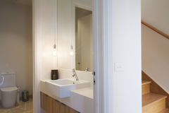 Stylish pendant light in powder room bathroom and Australian light switch royalty free stock photo