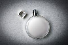 Stylish perfume on a gray background Stock Images