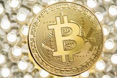 Stylish photo of Bitcoin golden coin on LED panel. Virtual cryptocurrency concept royalty free stock photography