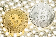 Stylish photo of two Bitcoins golden and silver coins on LED panel. royalty free stock photos
