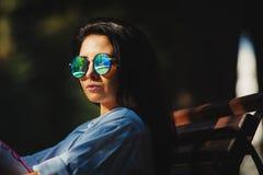 Stylish photo of woman in round sunglasses. Beautiful girl wears fashionable cicrular glasses royalty free stock photos