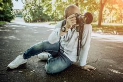 Stylish photographer with camera sidin on earth royalty free stock images