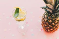 Stylish pineapple and mojito cocktail drink on trendy pink paper Stock Photo