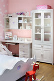 Stylish pink bedroom for girl with bed stock photos