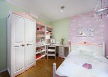 Stylish pink bedroom with wardrobe royalty free stock image