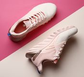Stylish pink new shoes on color background royalty free stock image