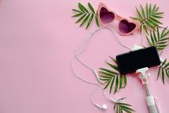 Free Stylish Pink Sunglasses, Phone On Selfie Stick, Headphones, And Royalty Free Stock Photo - 115819945