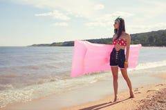 Stylish pinup girl posing. With swimming mattress Royalty Free Stock Photos