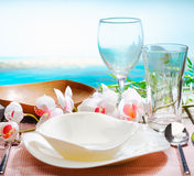 Stylish place setting with orchids Stock Photo