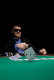 Stylish poker man. Two aces fold in texas hold'em poker at Las Vegas casino Stock Photos