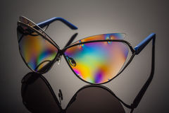 Stylish polarized colorful reflected sunglasses. Royalty Free Stock Photo