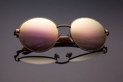Stylish polarized mirrored sunglasses on grey background. Royalty Free Stock Photography
