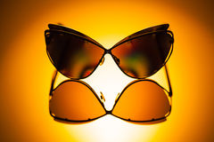 Stylish polarized mirrored sunglasses in sunlight. Royalty Free Stock Photography