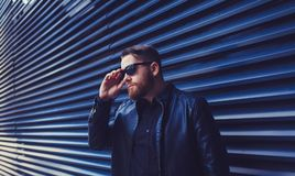 Stylish portrait bearded man in eyewear. Looking away while standing outdoors Royalty Free Stock Images