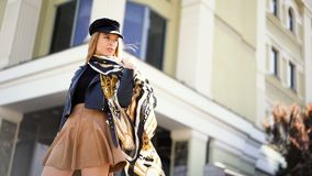 Stylish portrait model of outdoor. Fashion young woman posing outside in a city street. Stylish portrait model of outdoor. Fashion young woman posing outside in stock video footage