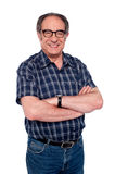 Stylish portrait of senior cheerful man. Posing with folded arms Royalty Free Stock Images