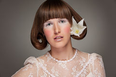 Stylish portrait of woman with flower Stock Photos