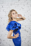 Stylish  posing Girl in luxurous blue dress Royalty Free Stock Photography