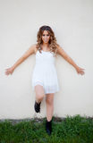 Stylish pretty girl with outstretched arms Stock Photos