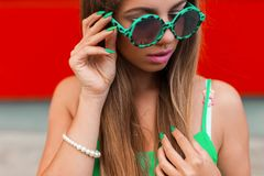 Stylish pretty girl in round sunglasses with pink lips stock photos