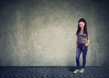 Stylish pretty woman against gray wall stock image