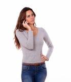Stylish pretty woman talking on cellphone Stock Image