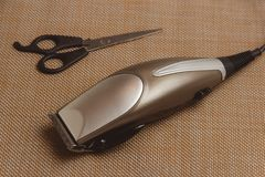 Stylish Professional Hair Clippers, accessories on brown background Stock Photography
